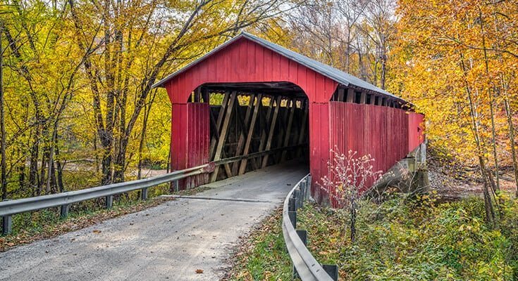 Autumn photography - Red covered bridge and autumn leaves